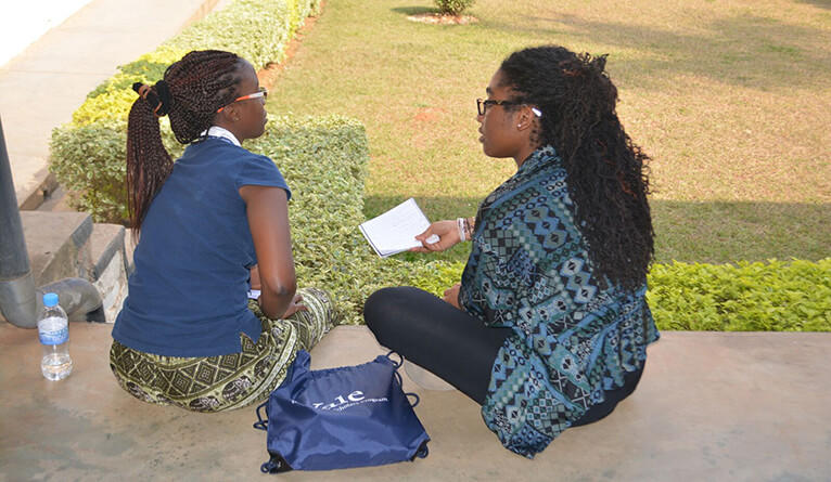 Ampofo consults a YAAS student.